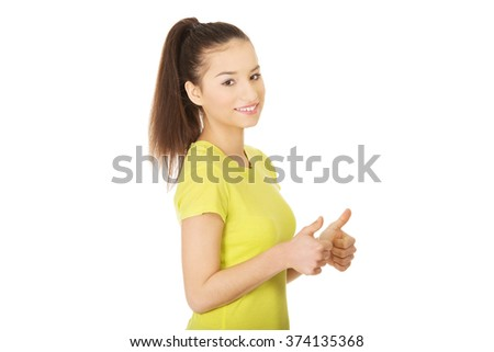 Happy woman with thumbs up. - stock photo