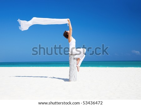 happy woman with white sarong on the beach - stock photo
