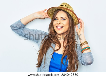 Happy woman  with yellow hat. Studio portrait. Female model with long hair. Beautiful girl. - stock photo