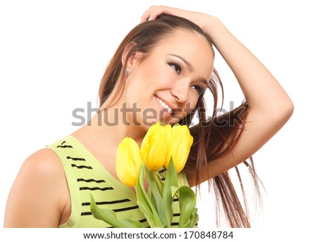 happy woman with yellow tulips over white background - stock photo