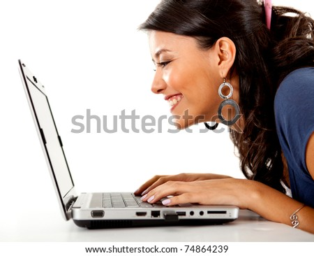 Happy woman working on a laptop computer ? isolated over white