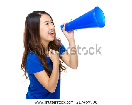 Happy woman yell with megaphone - stock photo