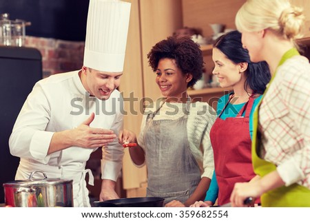 happy women and chef cook cooking in kitchen - stock photo