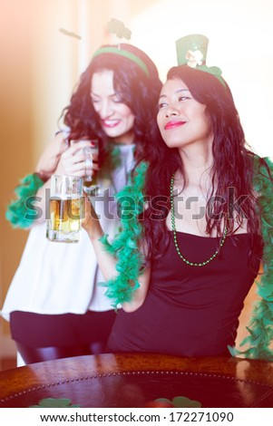 Happy women celebrating St Patrick's Day March 17th - stock photo