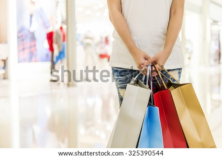 Happy Women holding shopping bags