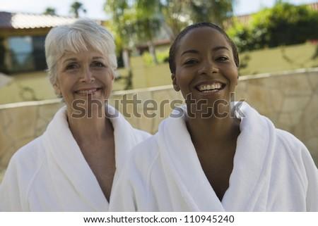 Happy women in bathrobe - stock photo