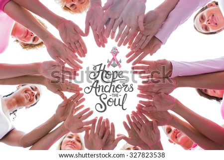 Happy women in circle wearing pink for breast cancer against breast cancer awareness message - stock photo