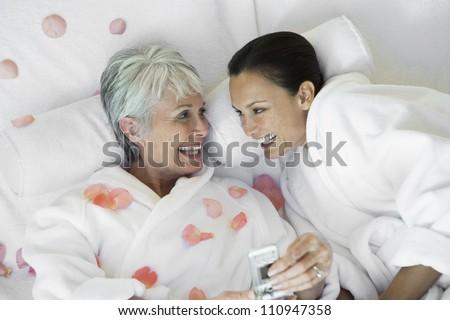 Happy women making cellphone call - stock photo