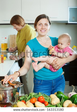 Happy women of three generations in domestic kitchen