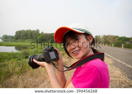 Happy women photographer on outdoor  - stock photo