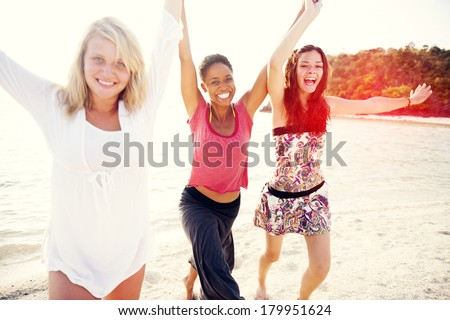 Happy Women Running and Holding Hands On Tropical Beach - stock photo