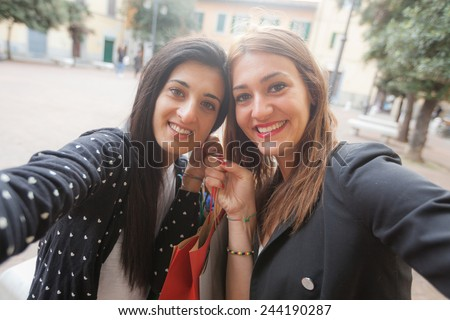 Happy Women Taking Selfie after Shopping. Taking Selfie and Sharing Photos on Social Networks is very common and fashion at the moment