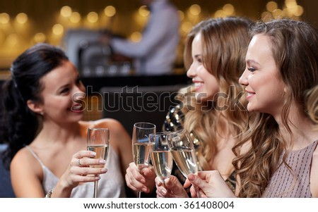 happy women with champagne glasses at night club - stock photo