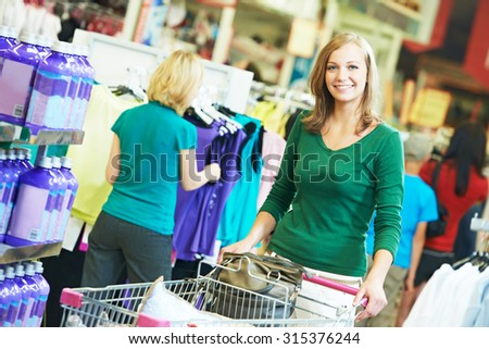 happy women with shopping cart at supermarket shopping mall store - stock photo