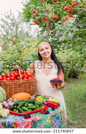 happy women with vegetables in garden