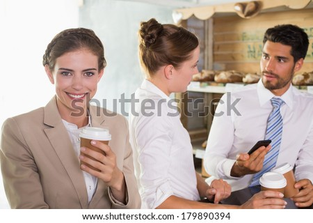 Happy work team during break time in office cafeteria - stock photo