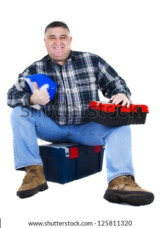 Happy worker seating on the tool box, white background - stock photo