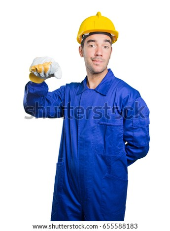 Happy workman showing his fist on white background