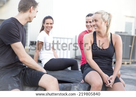 Happy workout team taking a break outdoor - stock photo