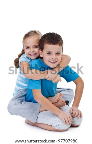 Happy wrestling kids playing together - isolated - stock photo