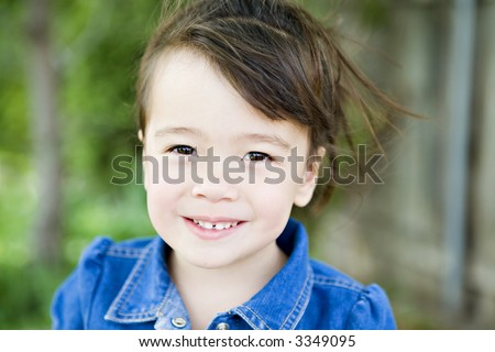 Happy 3-Year-Old Girl in her Backyard - stock photo