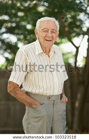 Happy 90 year old senior man standing outside - stock photo