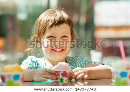 Happy 3 years child eating ice cream  - stock photo