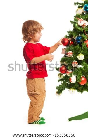 Happy 3 years old boy decorating Christmas tree, stinging isolated on white - stock photo