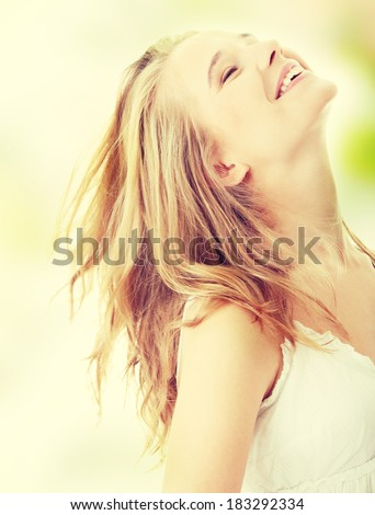 Happy yiung blond caucasian woman in white dress