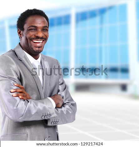 happy young african american businessman in office - stock photo