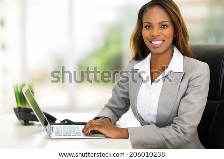 happy young african american businesswoman using computer in office - stock photo