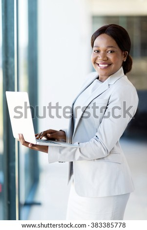 happy young african american businesswoman using laptop - stock photo