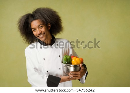 Happy Young African American Chef Holding Washed Vegetables in Strainer - stock photo