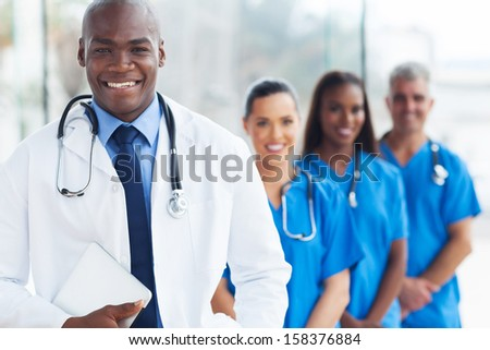 happy young african american doctor and colleagues - stock photo