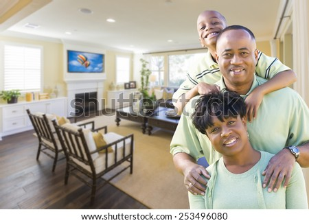 Happy Young African American Family In Their Living Room. - stock photo
