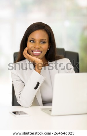 happy young african businesswoman relaxing in office