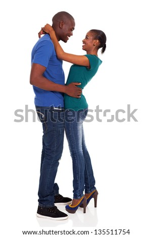 happy young african couple hugging on white background