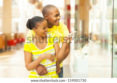 happy young african couple shopping in mall - stock photo