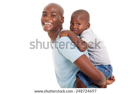 happy young african father carrying his son on his back
