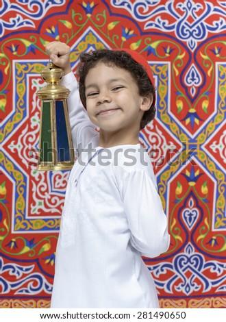 Happy Young Arabian Boy with Lantern Celebrating Ramadan - stock photo