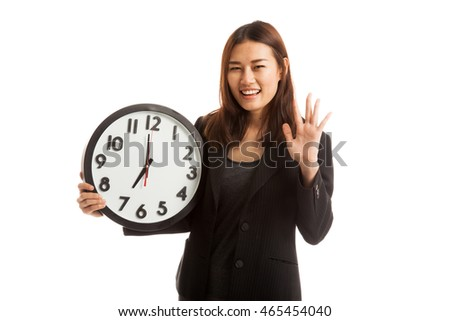 Happy Young Asian business woman with a clock  isolated on white background.