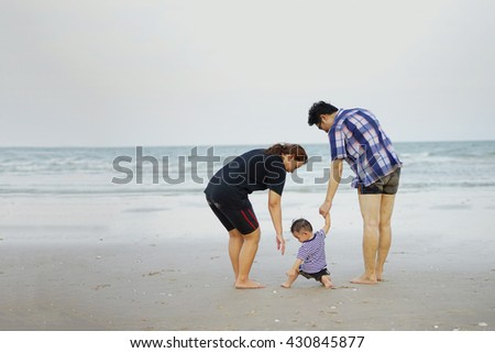 Happy Young Asian Family Having Fun Walking on at tropical beach vacation outdoors, vintage tone, Shallow DOF, Concept of happy father day.