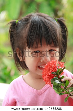 Happy young  asian girl smell flower and smiling