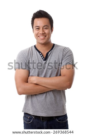 Happy young Asian man standing arms crossed smiling happy, looking at camera. - stock photo