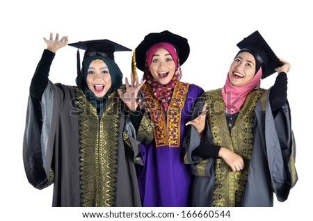 Happy young Asian Muslimah graduate student wearing graduation cap and gown
