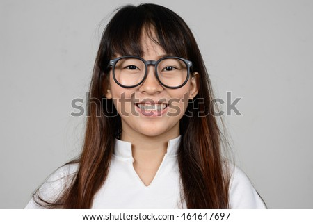 Happy young Asian nerd woman wearing eyeglasses