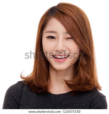 Happy young Asian woman close up shot. - stock photo