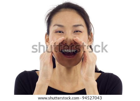 Happy young Asian woman loud screaming or calling out to someone isolated over white background