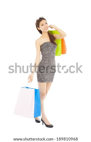 happy young  asian woman with shopping bags - stock photo