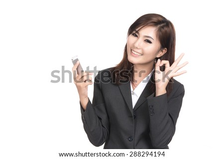 Happy young asian woman with smart phone and show ok sign with blank copyspace  for text,Portrait of beautiful Asian woman,Thai girl,Positive emotion facial expression,isolated on white background - stock photo